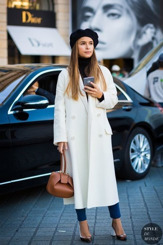 Miroslava Duma wearing White Coat, Black Turtleneck, Blue Skinny Jeans, Black Leather Pumps
