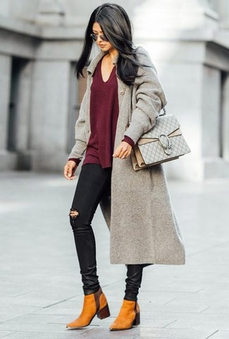 How to wear: grey coat, burgundy v-neck sweater, black ripped skinny jeans, tobacco suede chelsea boots