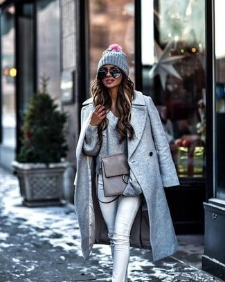 How to wear: grey coat, grey v-neck sweater, grey skinny jeans, grey leather satchel bag