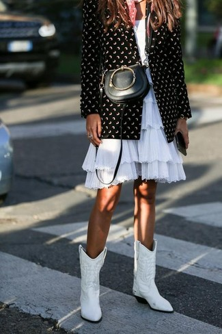 How to wear: black leather crossbody bag, white leather cowboy boots, white ruffle fit and flare dress, black and white print blazer