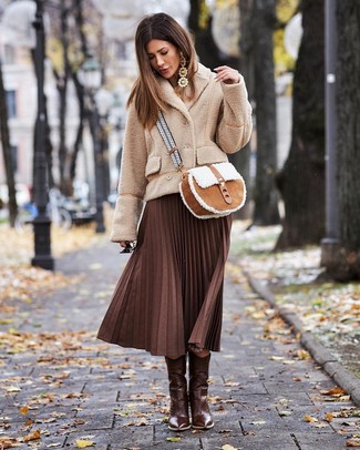 How to Wear Brown Leather Cowboy Boots For Women: This casual pairing of a beige fleece pea coat and a dark brown pleated midi skirt is very easy to throw together without a second thought, helping you look chic and prepared for anything without spending too much time combing through your wardrobe. Play down your look by slipping into a pair of brown leather cowboy boots.