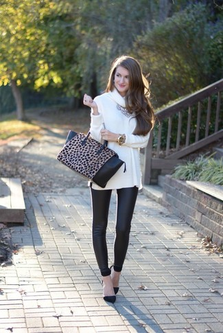 How to wear: white cowl-neck sweater, black leather leggings, black suede pumps, black and tan leopard leather tote bag