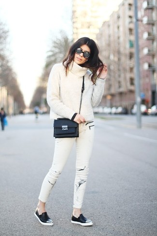How to wear: white cowl-neck sweater, white print skinny jeans, black leather slip-on sneakers, black leather crossbody bag