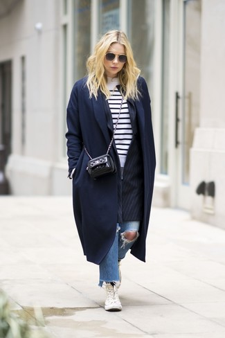 How to wear: blue ripped jeans, white and black horizontal striped crew-neck sweater, black vertical striped blazer, navy coat