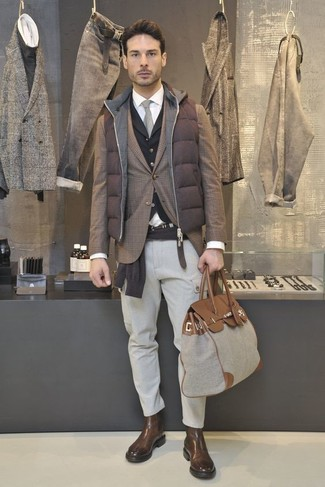 How to wear: black waistcoat, dark brown crew-neck sweater, brown plaid blazer, brown quilted gilet
