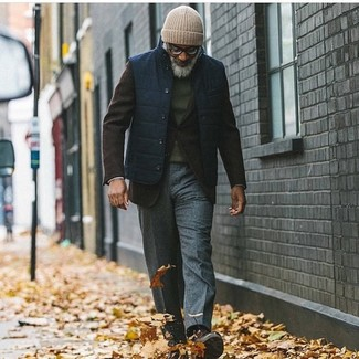 How to Wear Dark Brown Suede Casual Boots For Men: Reach for a navy gilet and charcoal wool dress pants for a proper elegant ensemble. A pair of dark brown suede casual boots effortlesslly amps up the wow factor of this getup.