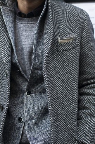 How to wear: black long sleeve shirt, grey crew-neck sweater, grey herringbone wool blazer, grey herringbone overcoat