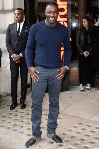 Idris Elba wearing Navy Crew-neck Sweater, Grey Chinos, Black Leather Espadrilles, Black Leather Belt