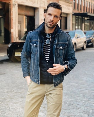 How to wear: khaki chinos, navy and white horizontal striped crew-neck sweater, navy denim jacket, navy quilted gilet