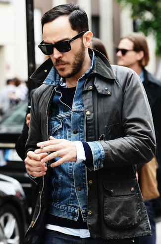 How to wear: white long sleeve shirt, navy crew-neck sweater, blue denim jacket, charcoal military jacket