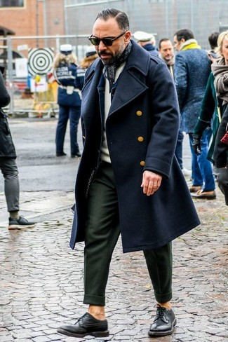 How to wear: olive dress pants, beige crew-neck sweater, navy denim jacket, black overcoat