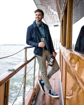 How to wear: beige chinos, navy crew-neck sweater, blue denim jacket, navy pea coat