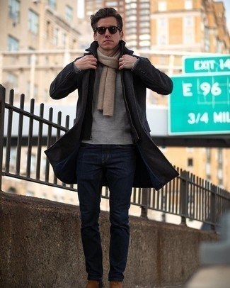 Men's Looks & Outfits: What To Wear In Winter: A charcoal overcoat and navy jeans are absolute must-haves if you're crafting a smart casual closet that matches up to the highest menswear standards. Infuse your look with an added touch of class by rocking brown suede chelsea boots. You bet this getup is great to stay snug and look great throughout the winter.