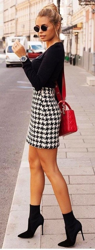 How to wear: black crew-neck sweater, white and black houndstooth mini skirt, black elastic ankle boots, red quilted leather crossbody bag