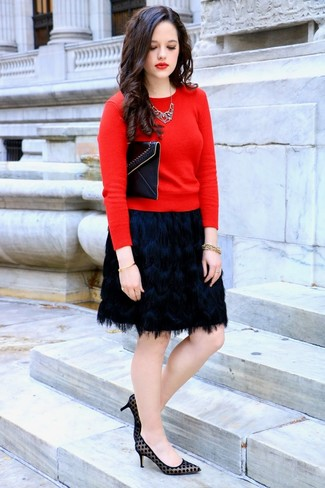 How to wear: red crew-neck sweater, black fringe mini skirt, black polka dot suede pumps, black leather clutch