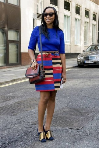 How to wear: blue crew-neck sweater, multi colored mini skirt, navy suede pumps, burgundy leather crossbody bag