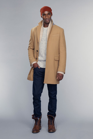 How to wear: navy jeans, white crew-neck sweater, beige shawl cardigan, camel overcoat