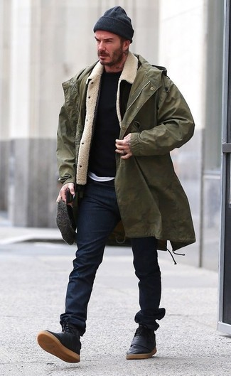 How to wear: white crew-neck t-shirt, black crew-neck sweater, black and white shearling jacket, olive fishtail parka