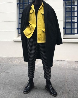 How to wear: black and white check chinos, black crew-neck sweater, yellow shirt jacket, black overcoat