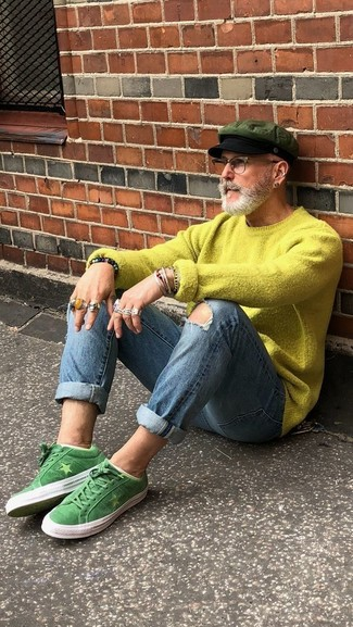 How to wear: green-yellow crew-neck sweater, blue ripped skinny jeans, green suede low top sneakers, olive flat cap