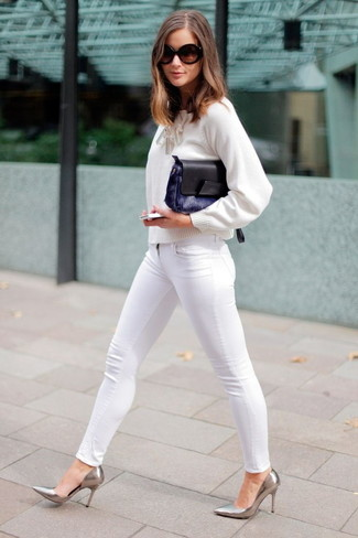 How to wear: white crew-neck sweater, white skinny jeans, silver leather pumps, navy fur clutch
