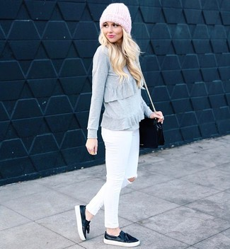 Make a grey ruffle crew-neck sweater and white ripped skinny jeans your outfit choice for a comfy-casual look. Black leather slip-on sneakers will become an ideal companion to your style. It goes without saying that this one makes for a great, spring-friendly combo.