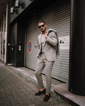 How to wear: dark brown suede loafers, beige crew-neck sweater, beige wool suit, grey overcoat