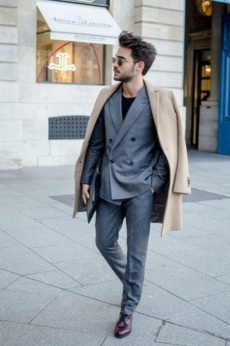 How to Wear a Black Crew-neck Sweater For Men: This pairing of a black crew-neck sweater and a beige overcoat might pack a punch, but it's also super easy to replicate. Add burgundy leather derby shoes to the mix to completely change up the outfit.