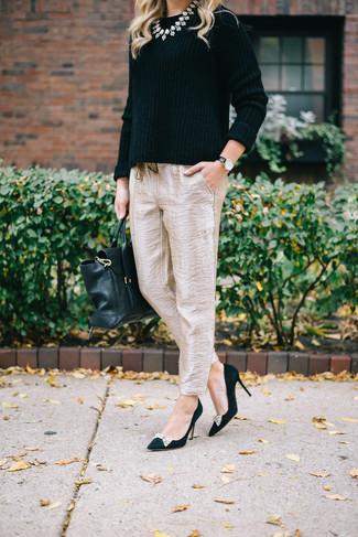 How to wear: black crew-neck sweater, beige silk tapered pants, black embellished suede pumps, black leather satchel bag