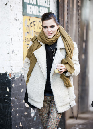 How to Wear Brown Skinny Pants: This combo of a white wool biker jacket and brown skinny pants looks seriously chic and makes you look instantly cooler.