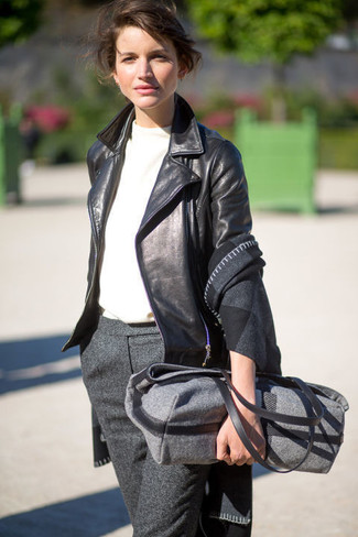 How to Wear a Charcoal Wool Tote Bag: Dress in a black leather biker jacket and a charcoal wool tote bag to achieve an interesting and modern-looking laid-back outfit.
