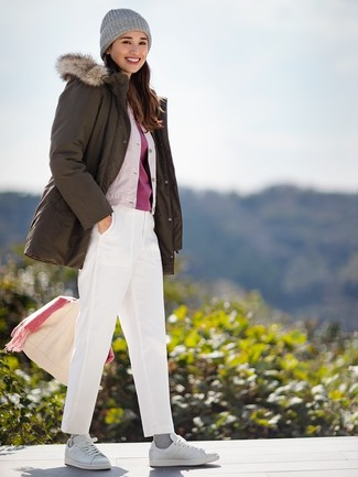 How to wear: white chinos, red crew-neck t-shirt, beige silk bomber jacket, olive parka