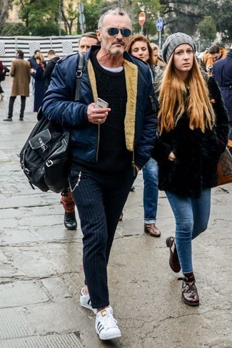 How to Wear a Navy Bomber Jacket For Men: You'll be amazed at how extremely easy it is for any man to get dressed this way. Just a navy bomber jacket and black vertical striped chinos. The whole outfit comes together if you introduce a pair of white and black leather low top sneakers to your look.
