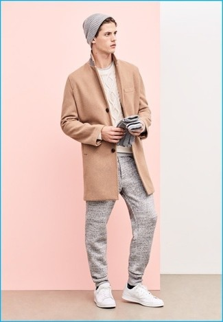 How to wear: grey sweatpants, grey crew-neck t-shirt, white cable sweater, camel overcoat