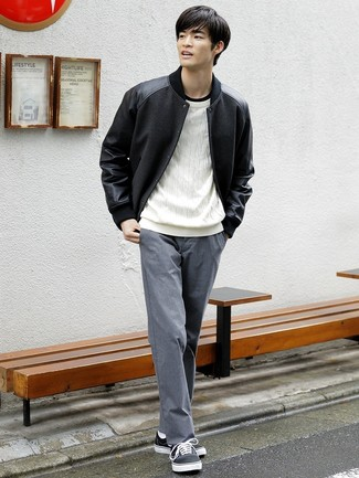 How to wear: grey chinos, black crew-neck t-shirt, white cable sweater, black varsity jacket