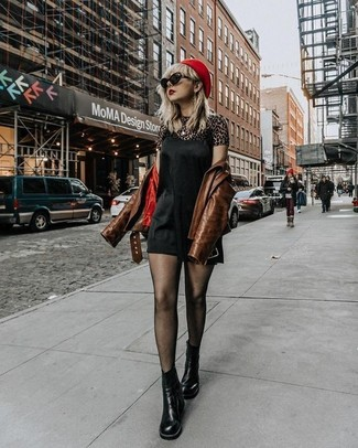 How to wear: black leather chelsea boots, brown leopard crew-neck t-shirt, black silk cami dress, brown leather biker jacket