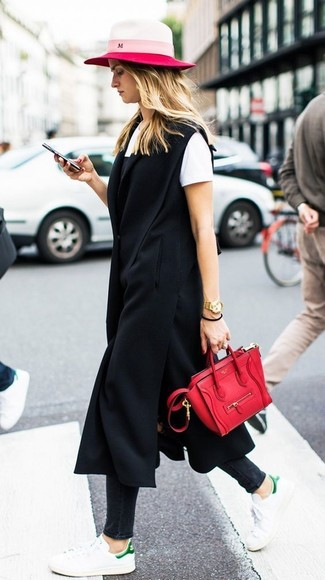How to wear: black skinny jeans, white crew-neck t-shirt, black cami dress, black sleeveless coat