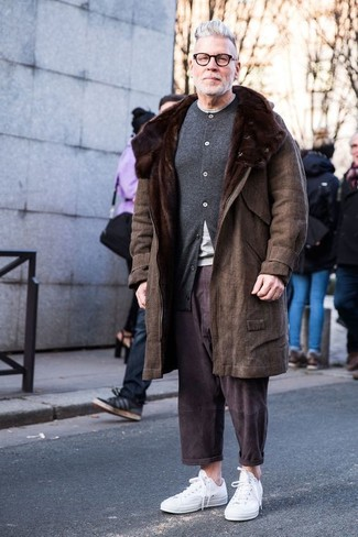 How to Wear a Grey Cardigan For Men: This combination of a grey cardigan and dark brown chinos is hard proof that a safe casual look doesn't have to be boring. To give this getup a more casual spin, complement this look with white low top sneakers.