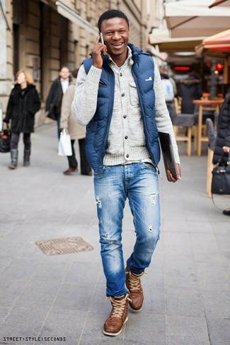 How to wear: blue ripped jeans, light blue crew-neck t-shirt, beige cardigan, blue gilet
