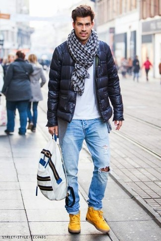 How to wear: light blue ripped jeans, white crew-neck t-shirt, grey cardigan, black puffer jacket