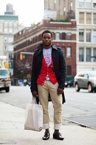 How to wear: khaki chinos, white and red print crew-neck t-shirt, red cardigan, black trenchcoat