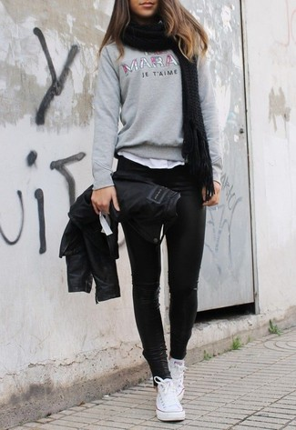 How to wear: black leather leggings, white crew-neck t-shirt, grey print crew-neck sweater, black leather biker jacket
