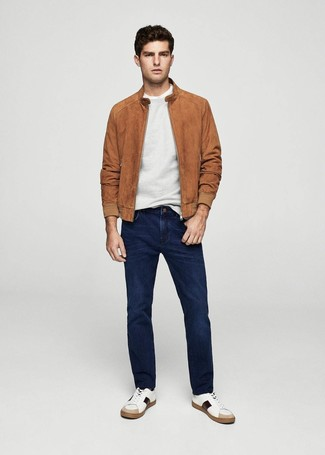 How to wear: navy jeans, white crew-neck t-shirt, grey crew-neck sweater, tobacco suede bomber jacket