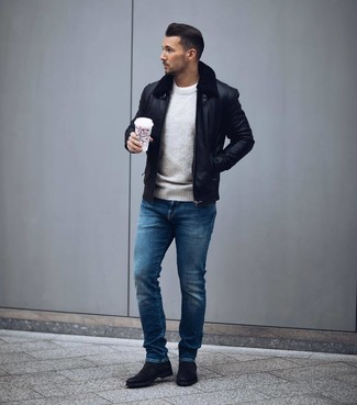 How to wear: blue jeans, white crew-neck t-shirt, grey crew-neck sweater, black leather bomber jacket