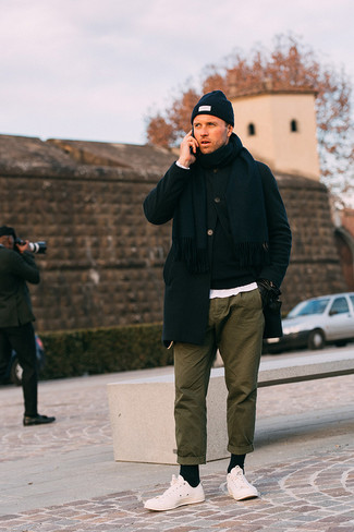 How to Wear Black Leather Gloves For Men: A black overcoat and black leather gloves are essential in any man's properly edited casual arsenal. The whole getup comes together brilliantly if you complete your outfit with a pair of white low top sneakers.