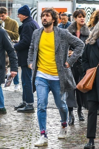 How to Wear a Yellow Crew-neck Sweater For Men: Wear a yellow crew-neck sweater with blue ripped jeans and you'll be ready for whatever this day has in store for you. Feeling creative today? Change things up a bit by wearing a pair of white leather low top sneakers.