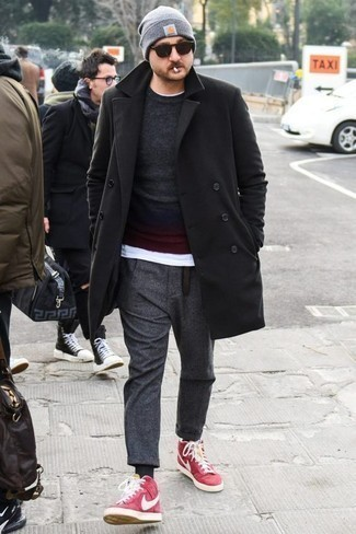 How to Wear a Black Leather Belt For Men: We're all looking for comfort when it comes to styling, and this relaxed casual combo of a black overcoat and a black leather belt is a practical example of that. Our favorite of an infinite number of ways to complete this getup is with hot pink canvas high top sneakers.