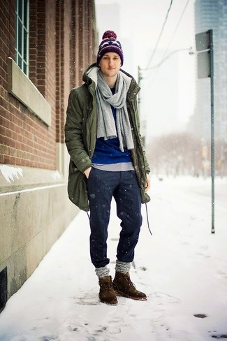 How to wear: charcoal wool chinos, grey crew-neck t-shirt, blue crew-neck sweater, olive parka