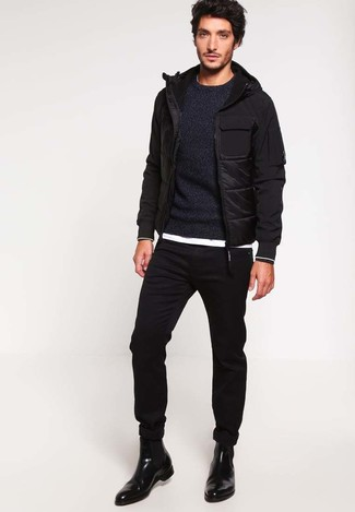 How to wear: black skinny jeans, white crew-neck t-shirt, black crew-neck sweater, black puffer jacket