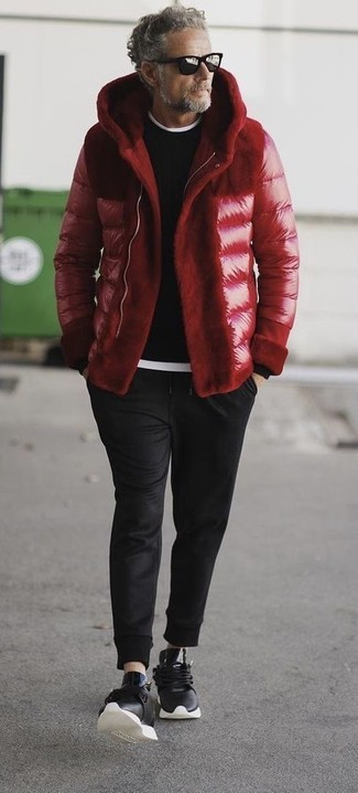 How to wear: black sweatpants, white crew-neck t-shirt, black crew-neck sweater, red puffer jacket